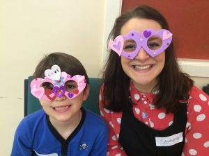 Children with Fancy dress paper glasses smiling